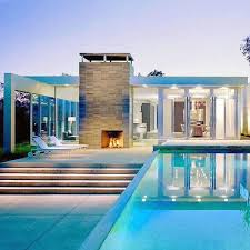 ultra modern luxury outdoor fireplace by swimming pool