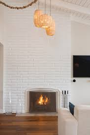 white brick fireplace and lantern pendants