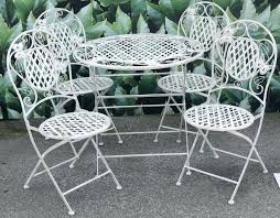 image of vintage wrought iron patio furniture seating outdoor chairs antique table and outdoo