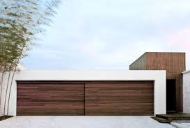 18 inspirational exles of modern garage doors a sliding wood door made from the