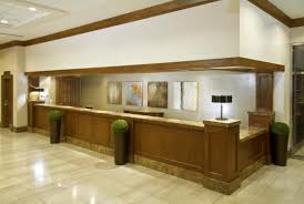 front office decorating ideas. Wooden Varnished Front Desk Design Brown Color Lacquired Good Looking Professional Classical Different Shapes Angles Notable Office Decorating Ideas H