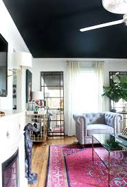 black ceiling white walls and stunning bright area rug bold rugs color