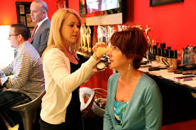 michele mann applying make up to a woman