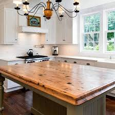 reclaimed chestnut table top made for the kitchen company