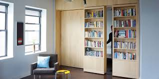 how to get more out of your walls rolling bookshelves shoji screens and glazed partitions moss architecture