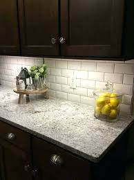 ice white granite paired with a beveled subway tile and mahogany cabinets countertop uneven colors subway tiles tile countertop