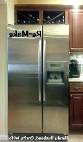 wine rack above fridge over refrigerator custom cabinet53 above