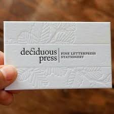debossed business cards like smooth center stripe also like name on side line then interior design on other side