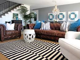 Living rooms with brown furniture Teal Wonderful Idea Of Living Room With Cozy Brown Leather Sofa Also Alluring Blue Cushion With Magnificent Homesfeed Brown Leather Sofa Great Piece Of Furniture You Should Have