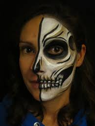 half skull face paint tutorial alana dunlevy is a bristol based face and painter here she guides you through creepy skull face painting