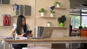 asian woman reading doents on touch screen tablet business woman working in modern office