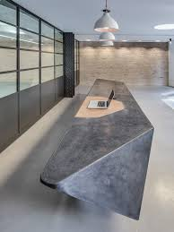 Pin Love this cast concrete reception desk - sleek and modern.