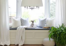 a diy window bench with storage adds character and charm to a simple window nook