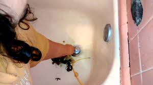 unclog bathtub drain with wire hanger in 3 minutes