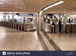 subway station turnstile. Unique Subway People Going Through Turnstiles In Subway Station With Subway Station Turnstile I
