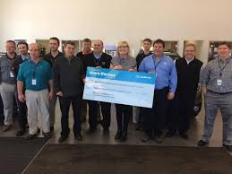 big brothers big sisters of marquette alger county receives 18 000 check from fox motors marquette