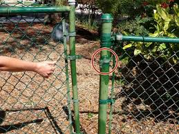 Broken chain link fence png Clip Art Remove The Unbolted Post Hinges From The Fence Posts Pixabay How To Replace Chain Link Fence Gate Ifixit Repair Guide
