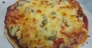 Cheesy pizza paratha Recipe by HINA IMTIAZ - Cookpad