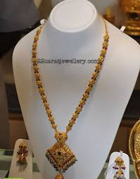 checkout beautiful 22 carat gold dala mala studded with rubys and emralds attached with gold pendant pendant also studded wit rubys emralds