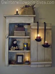 primitive lighting ideas. i like the lights in hanging spoons plan on lots of wall cabinets to hide shed walls primitive lighting ideas
