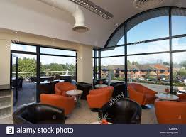 office seating area. Seating Coffee Area In Modern Office Building For Staff With Orange And Black Chairs View Through Window