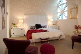 white bedroom with red maroon and gold