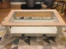wooden cream coffee table with drawers