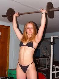 Nude women weight lift