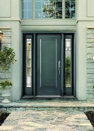 front door with sidelitesWoodgrain Wrought Iron Front Door with 2 Side lites installed in