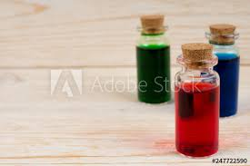 red blue and green magic potions in small glass bottles