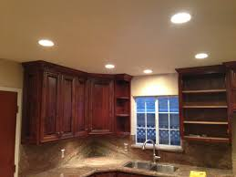 Led Recessed Lights With Brown Wooden Cabinet Small Window And Marble  Countertop In Minimalist Kitchen ...