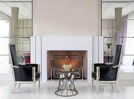 breezing glass fireplace screens with black chairs and