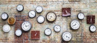 brick wall with small wall clocks