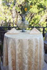 48 inch round cocktail table dressed with a 108 round melrose damask tablecloth