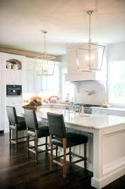 white kitchen chandelier marble subway tile beautiful crystal