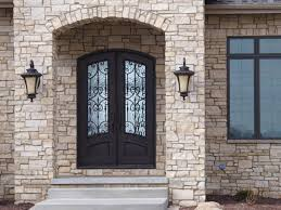 front double doors. arched double entry front doors