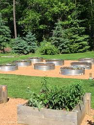 how to create raised garden beds with galvanized fire pit rings