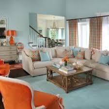 Coastal Aqua Living Room With Bold Orange Accents