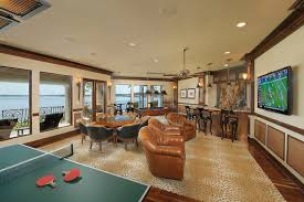 Basement game room ideas family room mediterranean with poker table chair  beige wall custom rugs