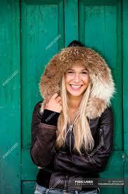 smiling teenage girl wearing hooded leather jacket stock photos