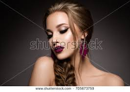 glamour portrait of beautiful model with makeup and romantic hairstyle fashion shiny highlighter on