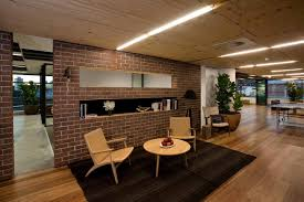 retro office interior with exposed brick partition style and wooden floor and ceiling and espresso colored awesome office design