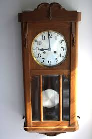 antique wooden wall clock with ornamentation very beautiful around 1940