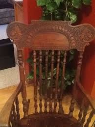 i have a rocking chair with a pentagram on the seat and two snarling dogs carved in the headrest i believe the chair belonged to my grandfather s mother