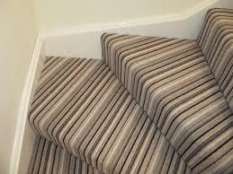 striped carpet on stairs around corners