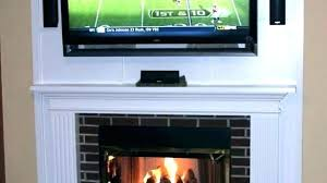 hide tv over fireplace mounting above hiding wires mount furniture white mounted hide tv over fireplace how to wires a solution mount