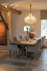 putty upholstered dining chairs and gorgeous taupe walls belgian style