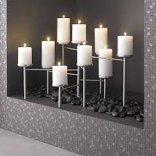 decor accessories the look of contemporary urban sculpture fills your fireplace with a flourish fireplace candelabrafaux