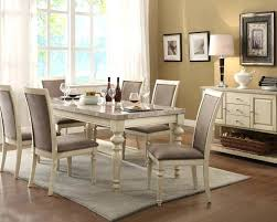 dark table white chairs dining room