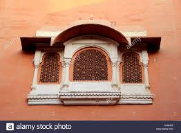 Concrete Window Design Concrete Window Frame With Intricate Design On Red Wall At